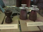 Wartime re-use: grenade egg-cup, shell candlesticks